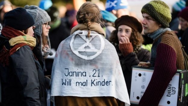 "Activist wears cloak saying ""Janina, 21, would like to have children"" in Berlin"