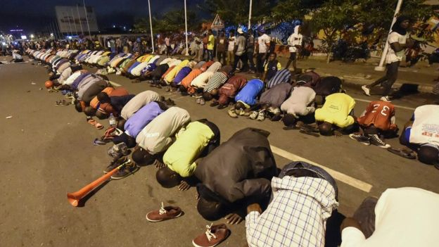 Opposition supporters praying during previous protests