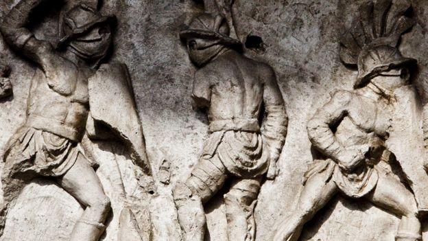 Friso con gladiadores romanos