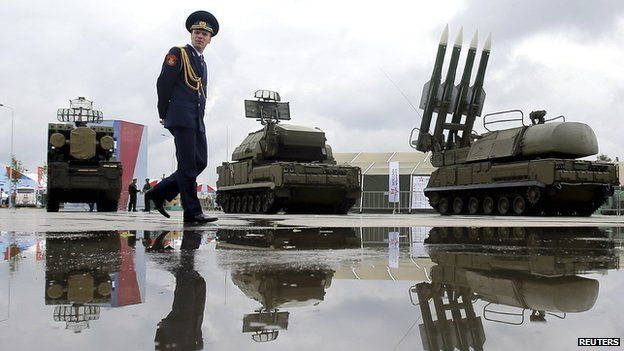 A Russian serviceman walks past the Buk-1M missile system at the Army-2015 international military forum in Kubinka, outside Moscow, Russia, on 16 June 2015