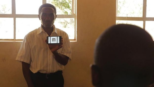 Picture of a teacher using the Peek app to test eye sight