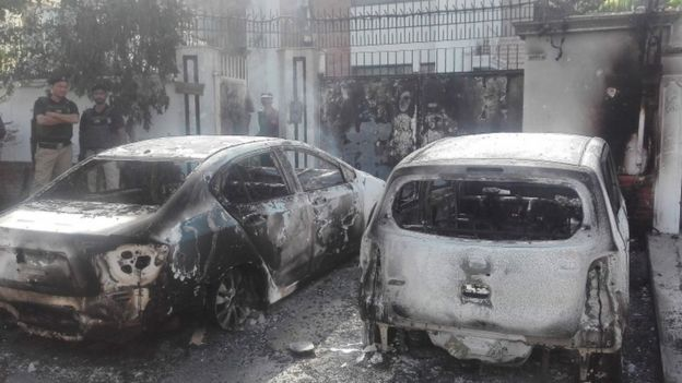 Burned out vehicles near the Chinese consulate in Karachi