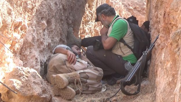 Abood Hamam with sleeping fighter in trench
