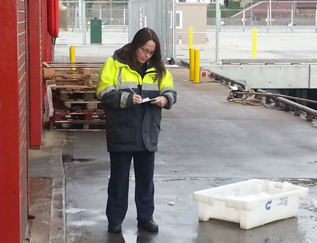 DeeAnn works as a fisheries officer checking the operation of the industry