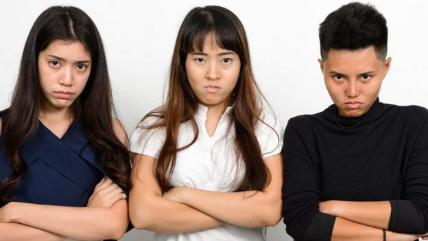 Stock picture of three Asian women looking unimpressed