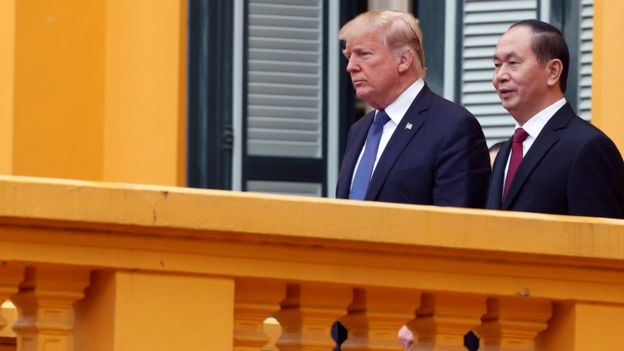 US President Donald Trump and Vietnam's President Tran Dai Quang walk to a news conference at the Presidential Palace in Hanoi, Vietnam November 12, 2017.