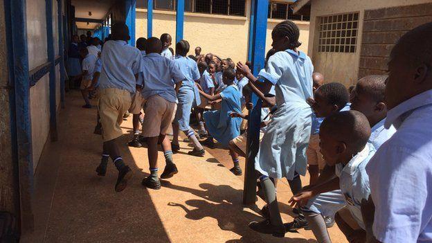 Pupils running to class