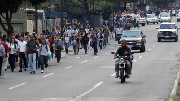 People walking in the streets of Caracas during extended power cuts March 2019