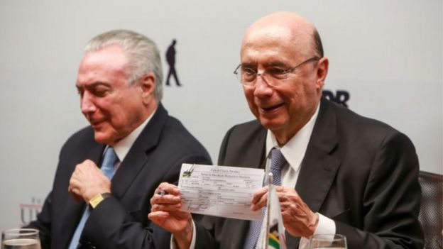 O presidente da República Michel Temer (esq.) e o ex-ministro Henrique Meirelles (dir.)