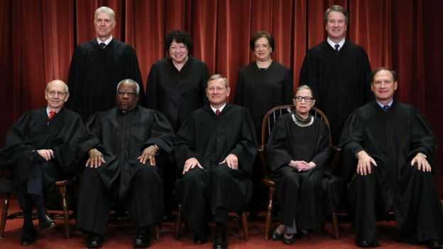 US Supreme Court (Front L-R) Stephen Breyer, Clarence Thomas, Chief Justice John Roberts, Ruth Bader Ginsburg, Samuel Alito, Jr; (Back L-R) Neil Gorsuch, Sonia Sotomayor, Elena Kagan and Brett Kavanaugh
