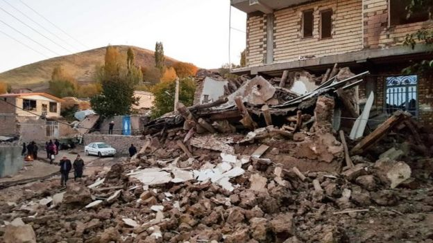 Debris of buildings in the Iranian village of Varnakesh on 8 November