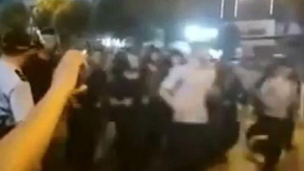 Social media footage of police in Wuhan