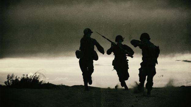 Três soldados na Segunda Guerra Mundial