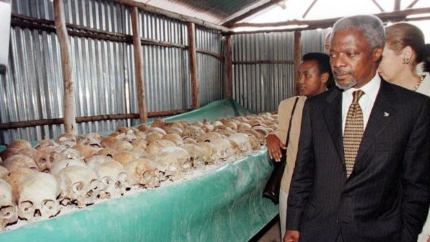 UN Secretary General Kofi Annan walks by skulls at the Mulire Genocide memorial 8 May 1998. Annan pressed ahead with his troubled visit to Rwanda, braving hecklers at the memorial site here for the 1994 genocide following his icy reception in Kigali.