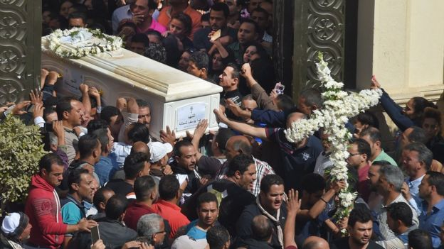 Coptic Christians carry the coffins of victims killed in an attack a day earlier,following a morning ceremony at the Prince Tadros church in Egypt