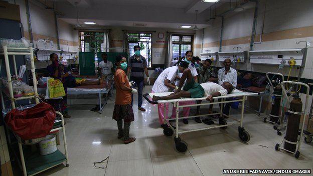 Victims of toxic alcohol receive treatment inside a Mumbai hospital