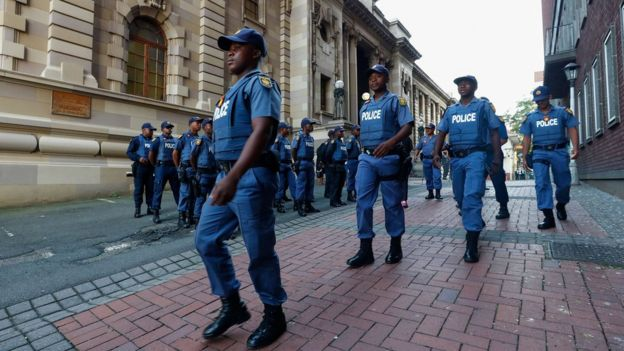 South African police muster outside the KwaZulu-Natal High Court in Durban on 6 April 2018