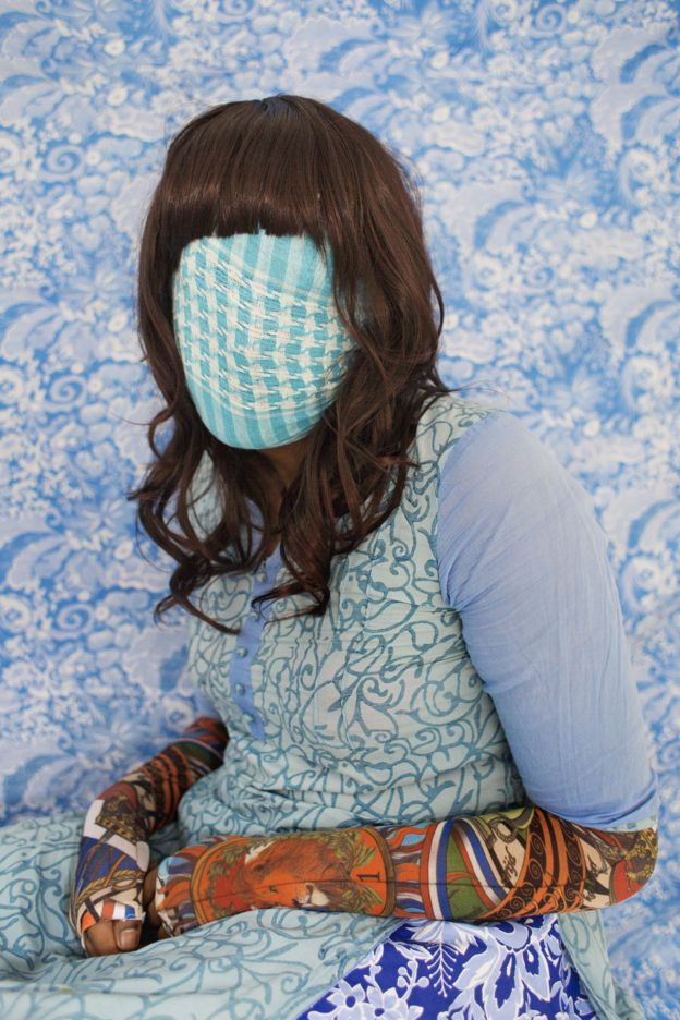 Bangladeshi woman with face covered by blue fabric