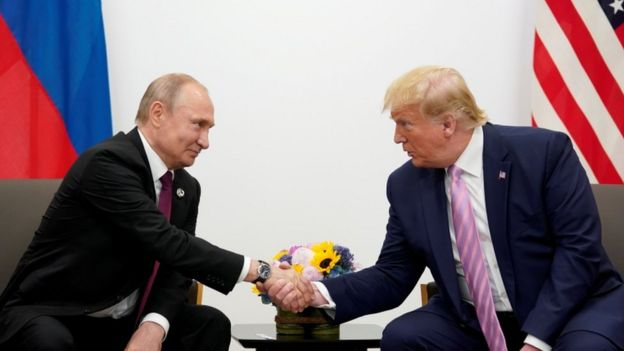 Russian President Vladimir Putin shakes hands with US President Donald Trump in 2019