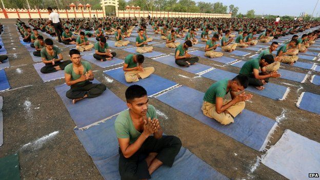 Indian Army personnel practice Yoga at a military station, ahead of World Yoga Day in Bhopal, India, on 20 June 2015.