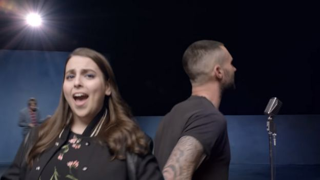 Beanie Feldstein and Adam Levine