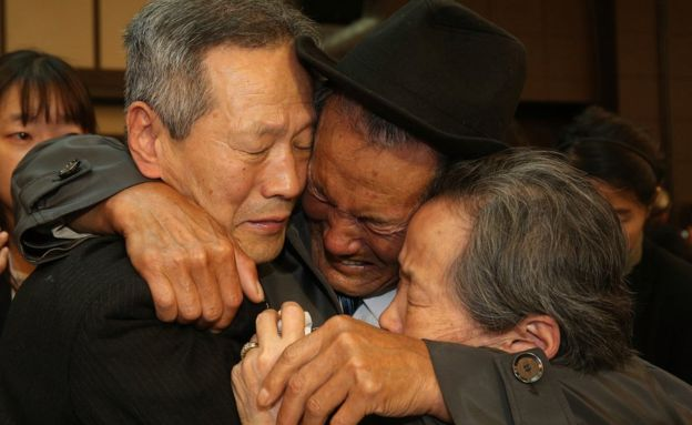 North Korean Son Gwon-Geun (C) cries with his South Korean relatives as they bid farewell following their family reunion on October 22, 2015 in Mount Kumgang, North Korea.