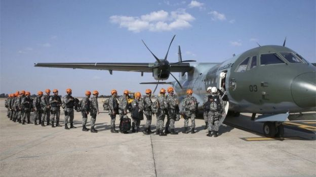 """A handout photo made available by the """"Agencia Brasil"""" shows National Forces members before boarding a plane to fight the fire at the Amazon forest in the state of Rondonia, Brazil, 25 August 2019."""