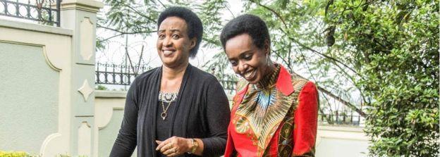 Diane Rwigara (R), a critic of Rwanda's President, and her mother Adeline Rwigara (L) walk in a garden