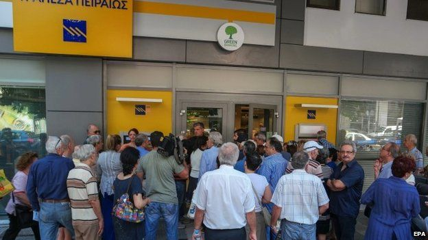 Greek pensioners queue to withdraw money from a bank in Athens