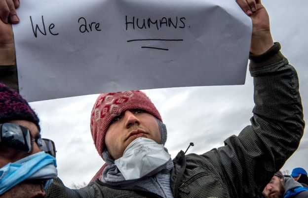 Iranian protester at Calais migrant camp (March 2016)
