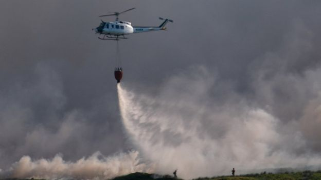 helicopter dropping water