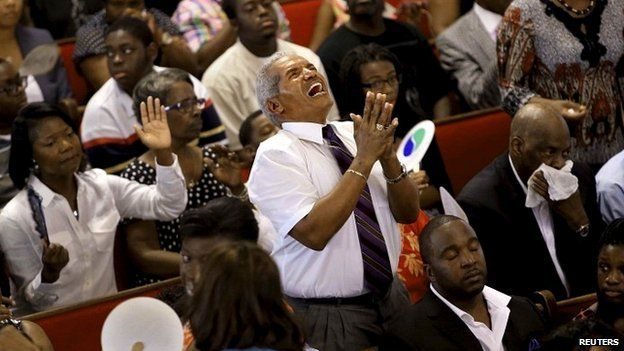 A man participates in a service at the Emanuel African Methodist Episcopal Church in Charleston, South Carolina, - 21 June 2015