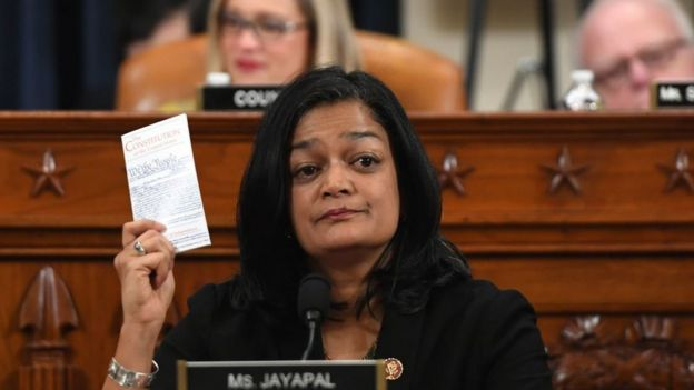 Democratic Congresswoman Pramila Jayapal held up a copy of the US constitution as she voted