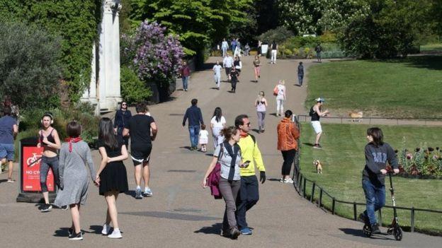 People walking in Kensington Gardens, in London, on Saturday 25 April