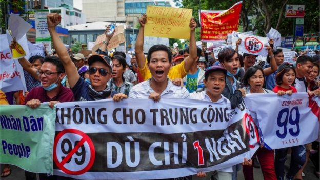 Protesters shout slogans against a proposed plan to grant companies lengthy land leases at a demonstration in Ho Chi Minh City 10 June 2018