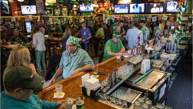 Patrons celebrate St. Patrick's Day at Kilroy's Restaurant & Sports Bar despite the world wide COVID-19 coronavirus pandemic, in Springfield, Virginia, USA, 17 March 2020