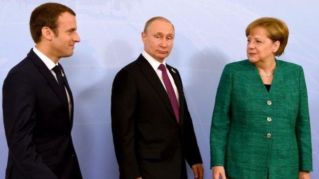 Macron, Putin and Merkel