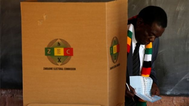"President Emmerson Mnangagwa checks his papers as he casts his ballot to vote in the country""s general election, at Sherwood Park Primary School in Kwekwe, Zimbabwe July 30, 2018."