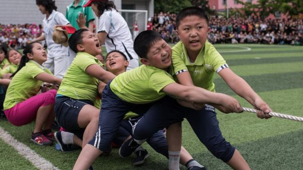Schoolchildren playing tug-of-war in Pyongyang