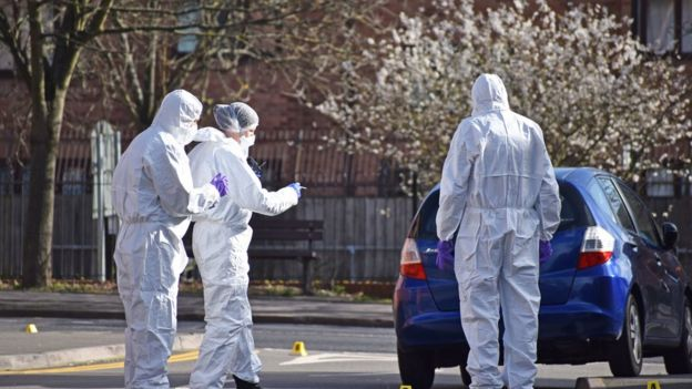 Police forensics officers searching for evidence in Chandos Street, Coventry, after the death of a 16-year-old boy following a stabbing