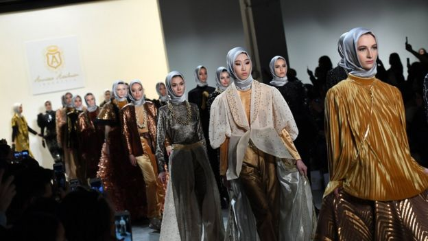 Models walk the runway for the Anniesa Hasibuan show during New York Fashion Week on February 14, 2017
