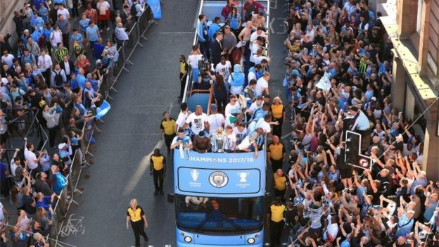Manchester City players on a open-top bus during the Premier League champions trophy parade,