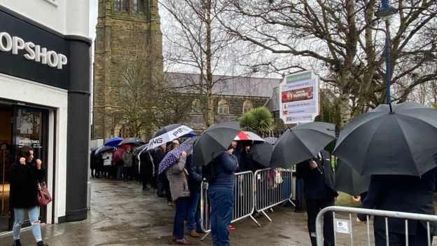Mourners outside the funeral of Harry Gregg