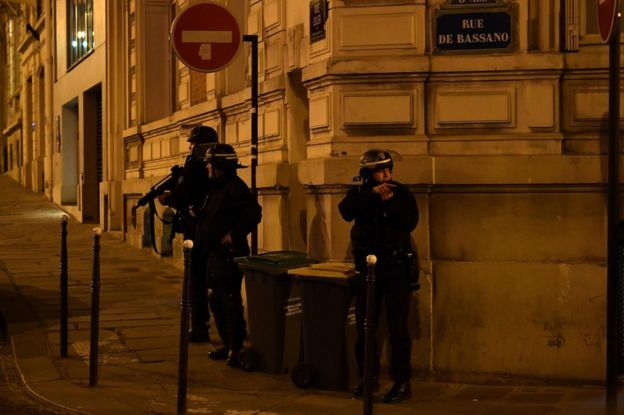 Police officers patrol near the site of a shooting at the Champs Elysees in Paris, 20 April