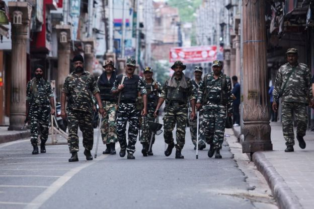 Security personnel patrol along a street in Jammu on August 6, 2019.