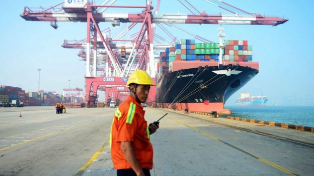 A man works at a port in China. File photo