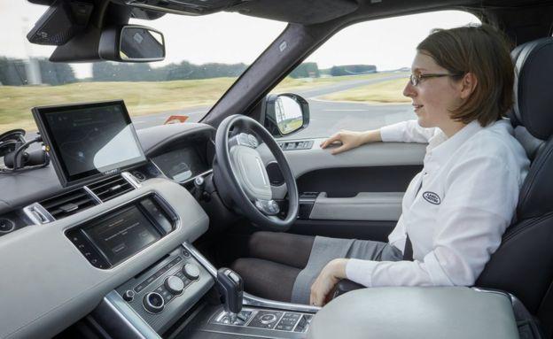 Dr Amy Rimmer sits in a Jaguar Land Rover autonomous car