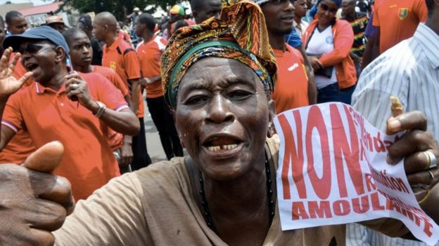 A demonstrator takes part in a protest against the third term of the Guinean President