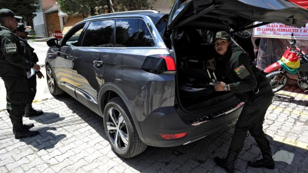 Police officers check a vehicle outside La Rinconada gated community, where the Mexican embassy is located, in La Paz on December 30, 2019.
