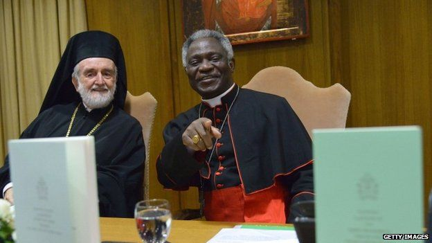 Orthodox metropolitan of Pergamon Joannis Zizioulas (left) and Cardinal Peter Kodwo Appiah Turkson smile during the official presentation of Pope Francis's encyclical during its official presentation, on 18 June 2015 at the Synod hall at the Vatican
